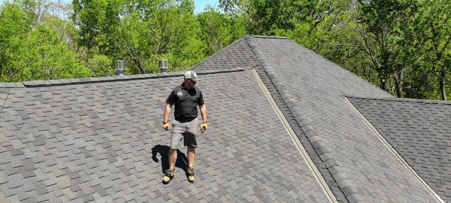 Contractor standing on roof